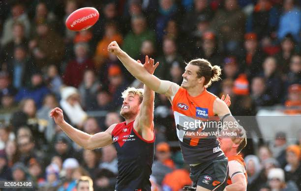 Jack Watts of the Demons and Phil Davis of the Giants contest a mark during the round 20 AFL match between the Greater Western Sydney Giants and the...