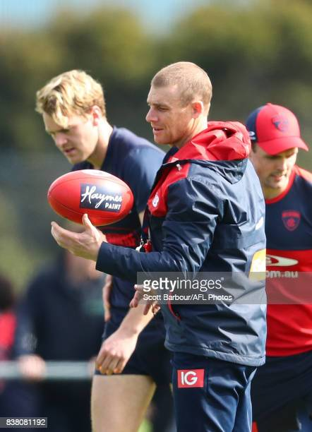 Jack Watts of the Demons and Simon Goodwin coach of the Demons look on during a Melbourne Demons AFL training session at Gosch's Paddock on August 24...