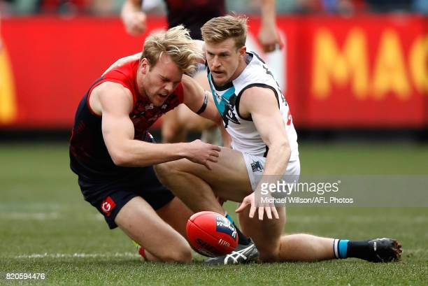 Jack Watts of the Demons and Tom Jonas of the Power compete for the ball during the 2017 AFL round 18 match between the Melbourne Demons and the Port...