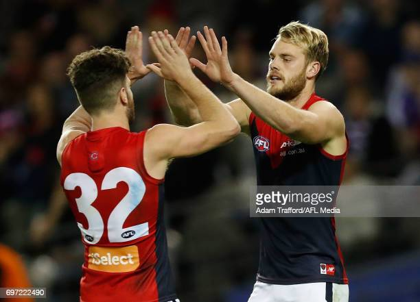 Jack Watts of the Demons celebrates a goal with Tomas Bugg of the Demons during the 2017 AFL round 13 match between the Western Bulldogs and the...