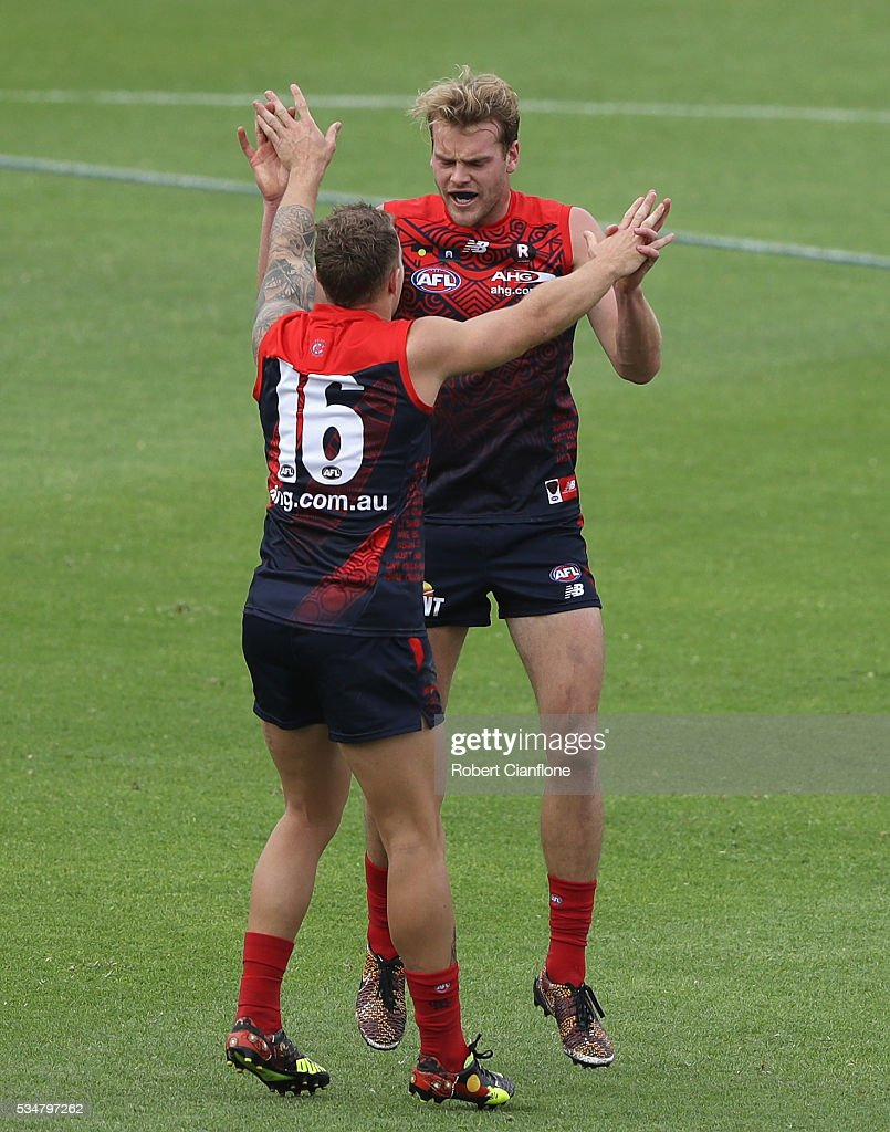 Jack Watts of the Demons celebrates with <a gi-track='captionPersonalityLinkClicked' href=/galleries/search?phrase=Dean+Kent&family=editorial&specificpeople=235553 ng-click='$event.stopPropagation()'>Dean Kent</a> after scoring a goal during the round 10 AFL match between the Melbourne Demons and the Port Adelaide Power at Traeger Park on May 28, 2016 in Alice Springs, Australia.