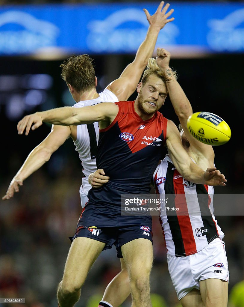 Jack Watts of the Demons collides with Jack Newnes and Tom Hickey of the Saints during the round six AFL match between the Melbourne Demons and the St Kilda Saints at Etihad Stadium on April 30, 2016 in Melbourne, Australia.