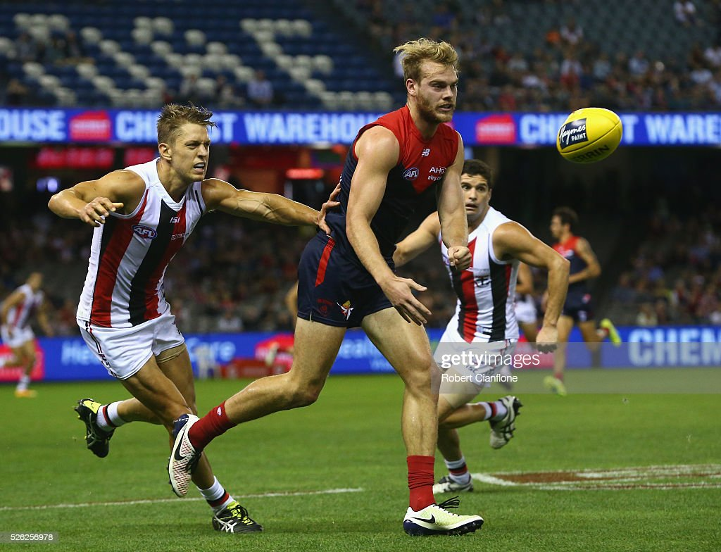 Jack Watts of the Demons handballs during the round six AFL match between the Melbourne Demons and the St Kilda Saints at Etihad Stadium on April 30, 2016 in Melbourne, Australia.