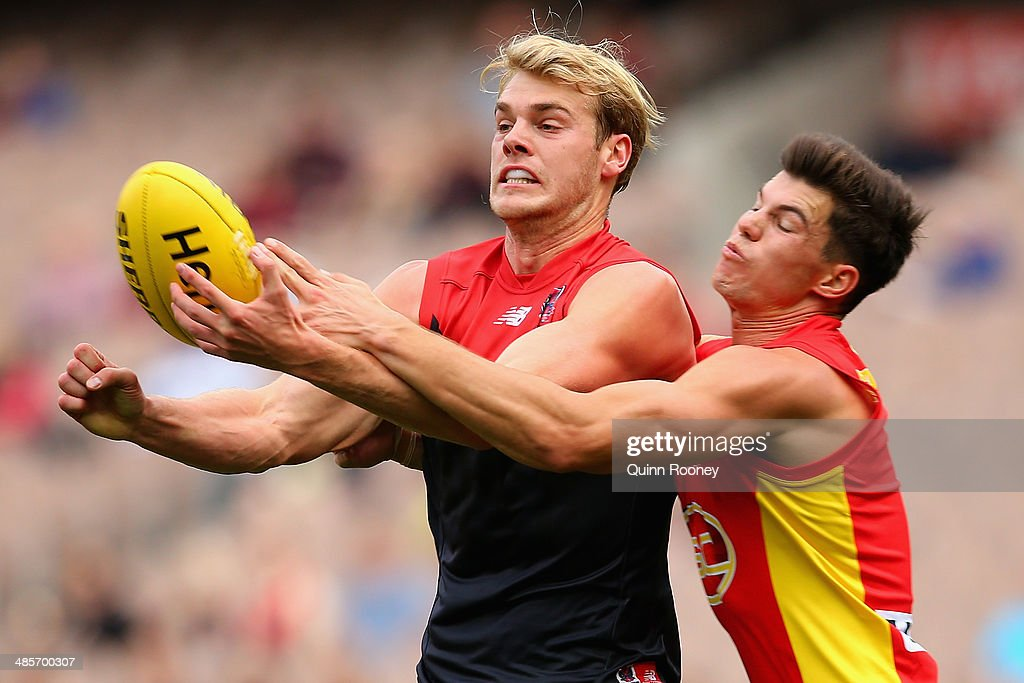 Jack Watts of the Demons handballs whilst being tackled by<a gi-track='captionPersonalityLinkClicked' href=/galleries/search?phrase=Jaeger+O%27Meara&family=editorial&specificpeople=8945123 ng-click='$event.stopPropagation()'>Jaeger O'Meara</a> of the Suns during the round five AFL match between the Melbourne Demons and the Gold Coast Suns at Melbourne Cricket Ground on April 20, 2014 in Melbourne, Australia.
