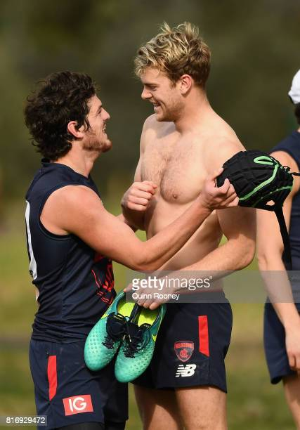 Jack Watts of the Demons has a laugh with Angus Brayshaw during a Melbourne Demons AFL training session at Gosch's Paddock on July 18 2017 in...