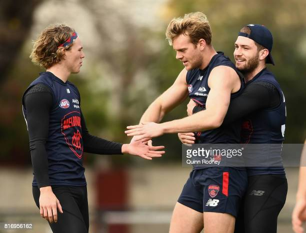 Jack Watts of the Demons is greated by Jayden Hunt and Tomas Bugg during a Melbourne Demons AFL training session at Gosch's Paddock on July 18 2017...