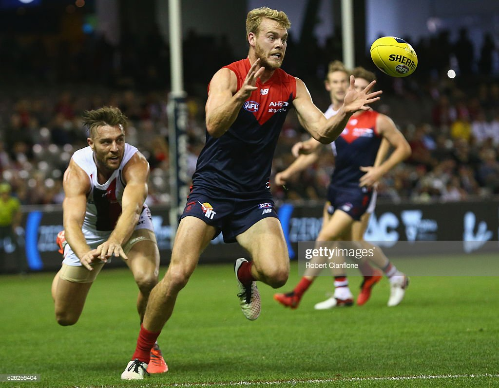 Jack Watts of the Demons looks to take the ball during the round six AFL match between the Melbourne Demons and the St Kilda Saints at Etihad Stadium on April 30, 2016 in Melbourne, Australia.