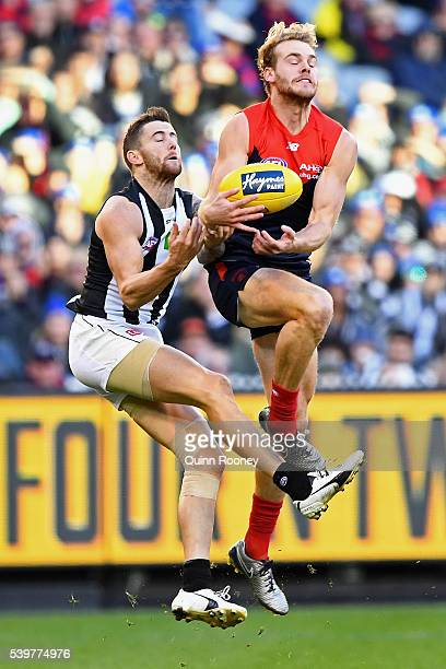 Jack Watts of the Demons marks infront of Jeremy Howe of the Magpies during the round 12 AFL match between the Melbourne Demons and the Collingwood...