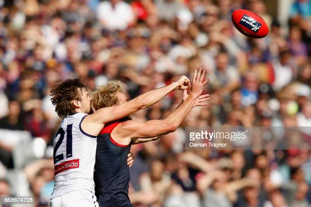 Jack Watts of the Demons marks the ball in front of Joel Hamling of the Dockers during the round four AFL match between the Melbourne Demons and the...