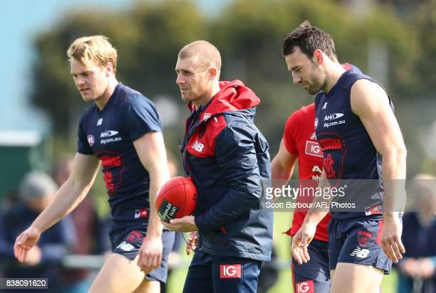 Jack Watts of the Demons Simon Goodwin coach of the Demons and Cameron Pedersen of the Demons look on during a Melbourne Demons AFL training session...