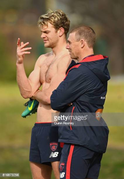 Jack Watts of the Demons speaks to head coach Simon Goodwin during a Melbourne Demons AFL training session at Gosch's Paddock on July 18 2017 in...