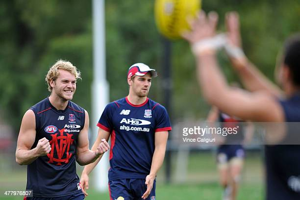 Jack Watts reacts after winning a kicking drill against teammate during a Melbourne Demons AFL training session at Gosch's Paddock on March 12 2014...