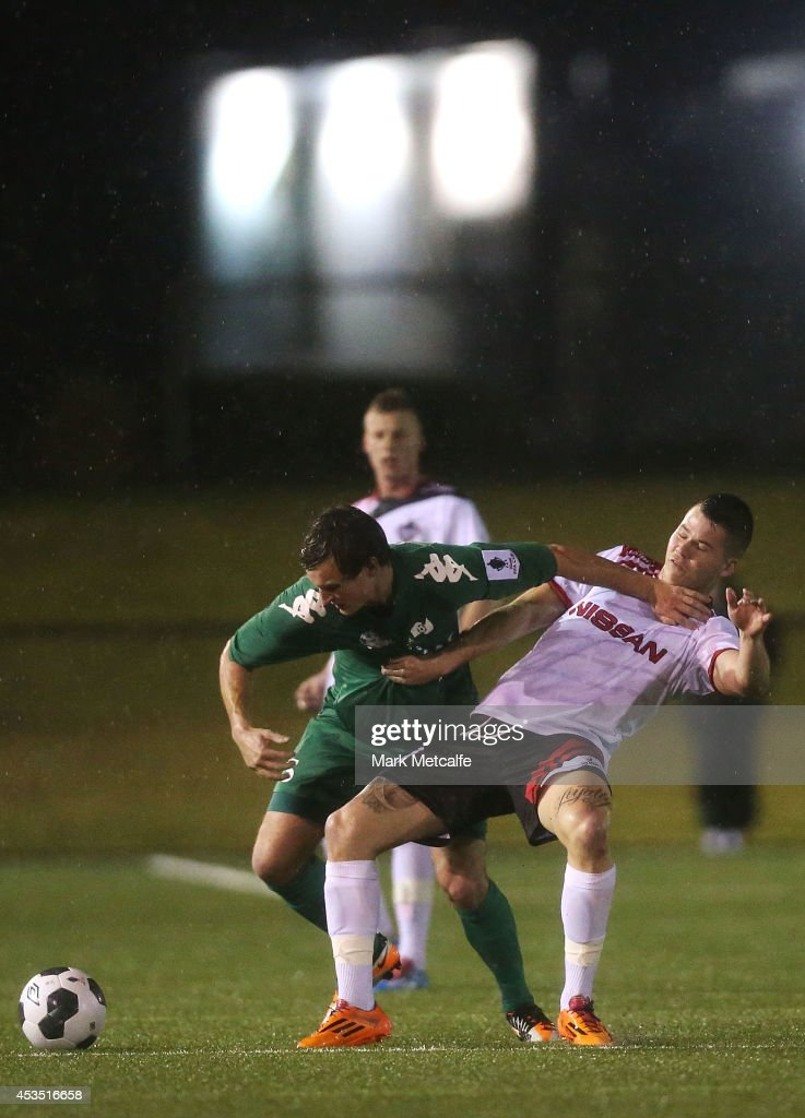 Jack Webster of Bentleigh Greens holds off the challenge of Travis Major of Blacktown City during the FFA Cup match between Blacktown City and Bentleigh Greens at Lilys Football Centre on August 12, 2014 in Blacktown, Australia.