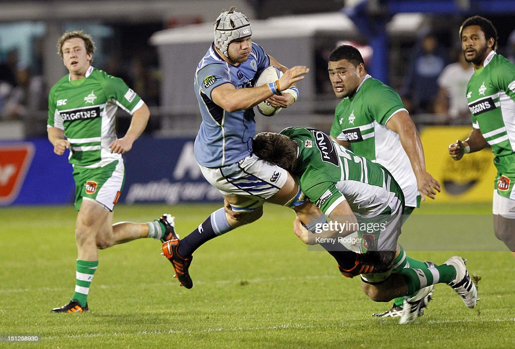 Jack Whetton of Northland is hit in a tackle during the round four ITM Cup match between Northland and Manawatu at Toll Stadium on September 5, 2012 in Whangarei, New Zealand.