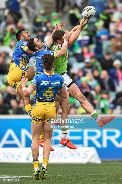 Jack Wighton of the Raiders fends a high ball backwards during the round 24 NRL match between the Canberra Raiders and the Parramatta Eels at GIO...