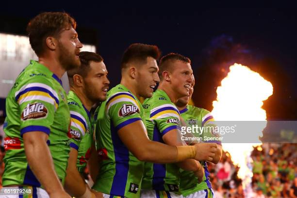 Jack Wighton of the Raiders is congratulated by team mates after scoring a try during the round two NRL match between the Canberra Raiders and the...