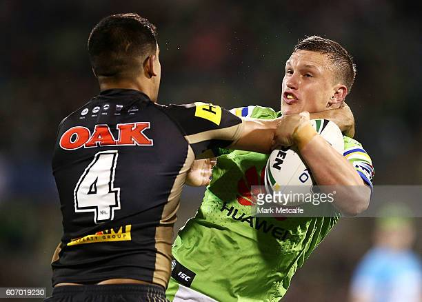Jack Wighton of the Raiders is tackled by Tyrone Peachey of the Panthers during the second NRL Semi Final match between the Canberra Raiders and the...