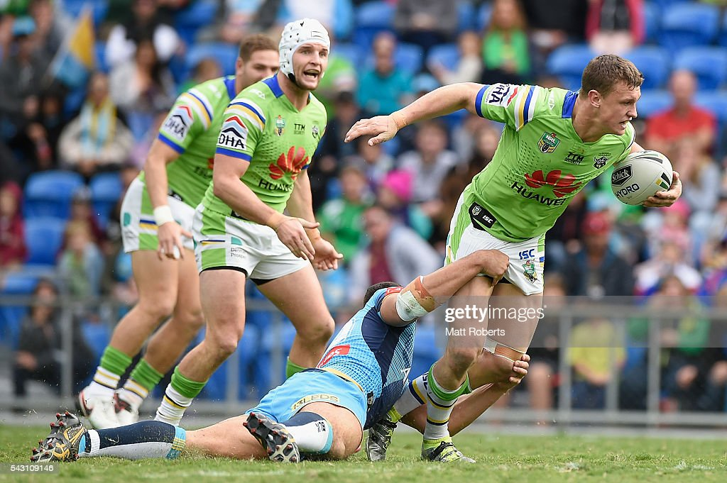 Jack Wighton of the Raiders is tackled during the round 16 NRL match between the Gold Coast Titans and the Canberra Raiders at Cbus Super Stadium on June 26, 2016 in Gold Coast, Australia.