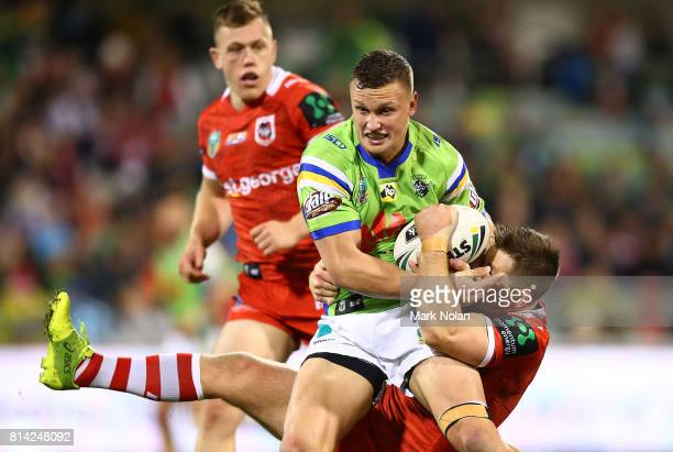 Jack Wighton of the Raiders is tackled during the round 19 NRL match between the Canberra Raiders and the St George Illawarra Dragons at GIO Stadium...