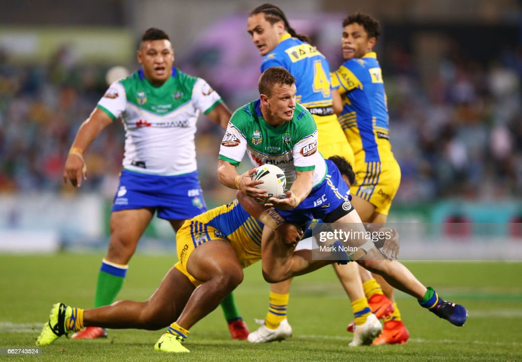 Jack Wighton of the Raiders looks to offload during the round five NRL match between the Canberra Raiders and the Parramatta Eels at GIO Stadium on April 1, 2017 in Canberra, Australia.