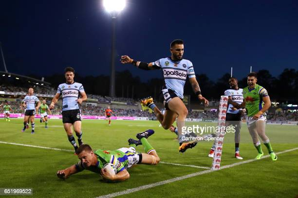 Jack Wighton of the Raiders scores a try during the round two NRL match between the Canberra Raiders and the Cronulla Sharks at GIO Stadium on March...