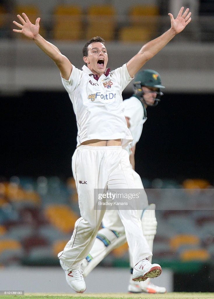 Jack Wildermuth of Queensland takes the wicket of Beau Webster of Tasmania during day one of the Sheffield Shield match between Queensland and Tasmania at The Gabba on February 14, 2016 in Brisbane, Australia.
