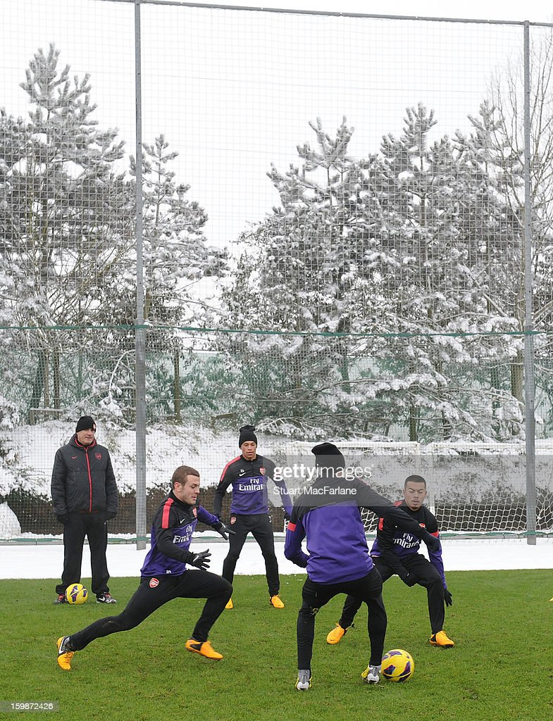 Jack Wilshere, Alex Oxlade-Chamberlain, Carl Jenkinson and Nico Yennaris of Arsenal in action during a training session at London Colney on January 22, 2013 in St Albans, England.