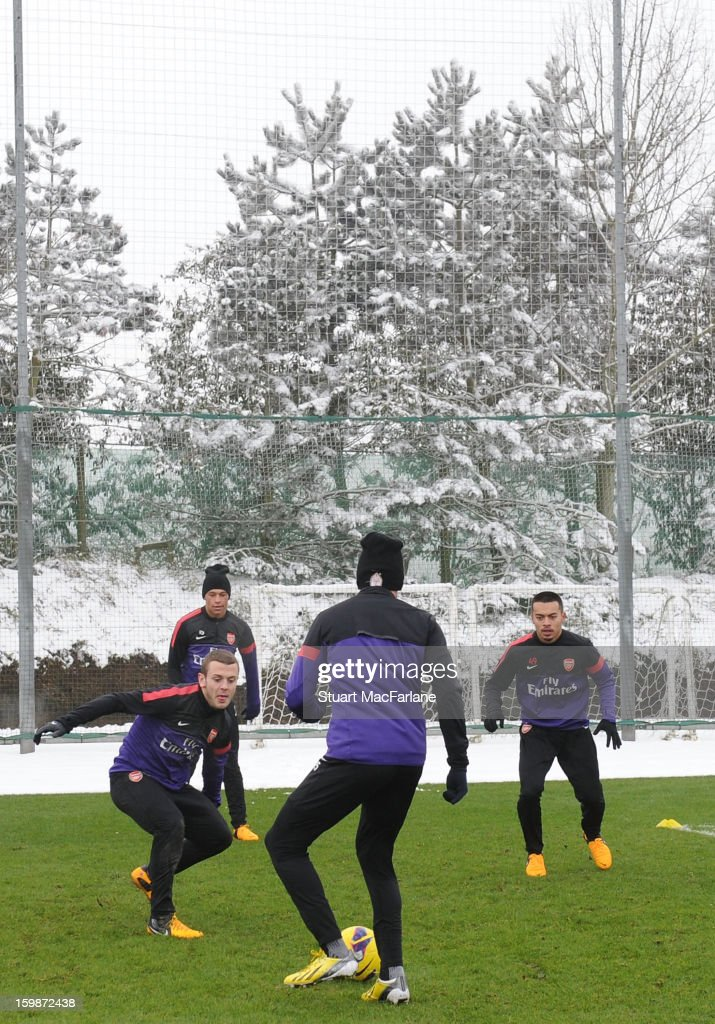 Jack Wilshere, Alex Oxlade-Chamberlain, Carl Jenkinson and Nico Yennaris of Arsenal during a training session at London Colney on January 22, 2013 in St Albans, England.