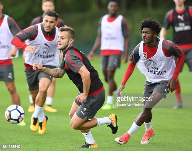 Jack Wilshere and Ainsley MaitlandNiles of Arsenal during a training session at London Colney on August 18 2017 in St Albans England