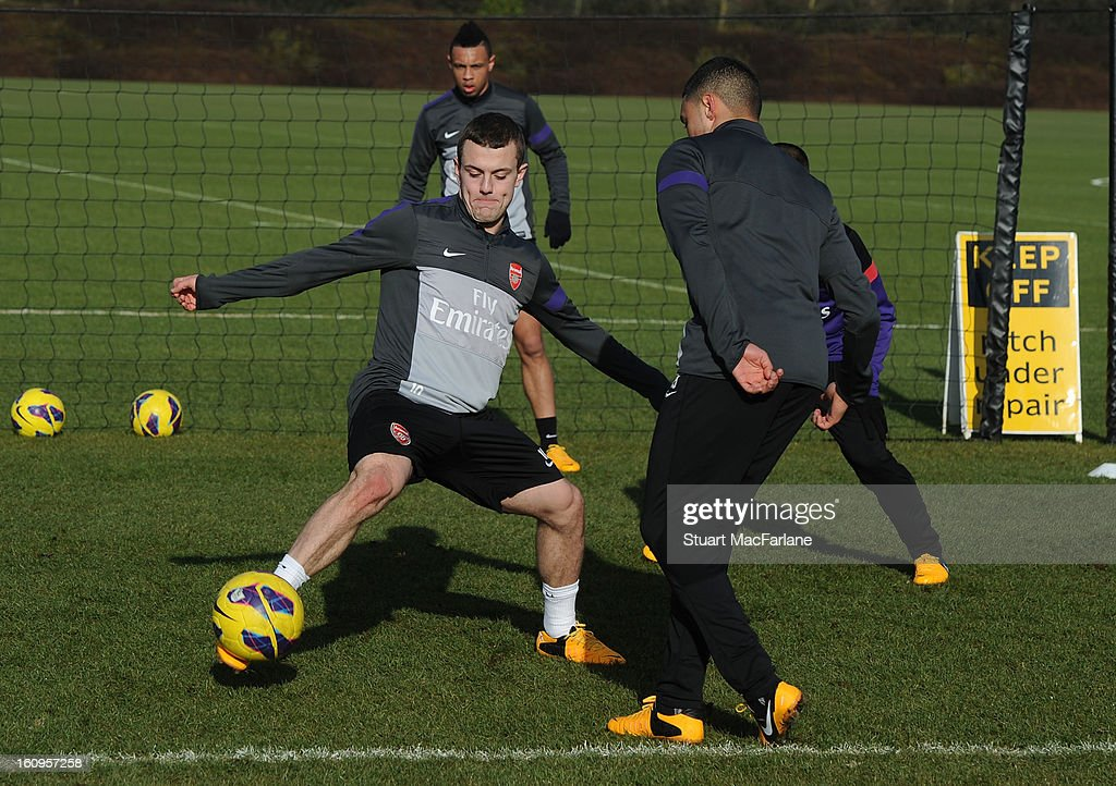 Jack Wilshere and Alex Oxlade-Chamberlain of Arsenal during a training session at London Colney on February 08, 2013 in St Albans, England.