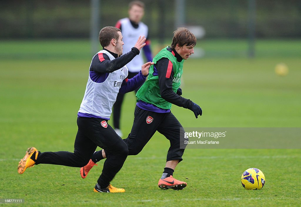 Jack Wilshere and Andrey Arshavin of Arsenal during a training session at London Colney on December 28, 2012 in St Albans, England.