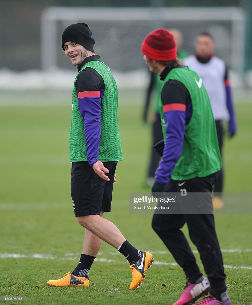 Jack Wilshere and Andrey Arshavin of Arsenal during a training session at London Colney on January 15, 2013 in St Albans, England.