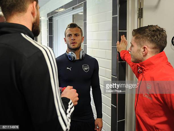 Jack Wilshere and Dan Crowley of Arsenal chat to Josh Vickers of Swansea before the match between Swansea City and Arsenal at Landore Training Ground...