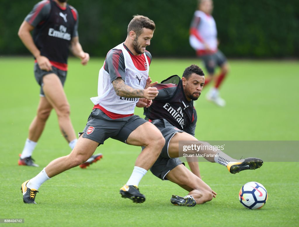 Jack Wilshere and Francis Coquelin of Arsenal during a training session at London Colney on August 24, 2017 in St Albans, England.
