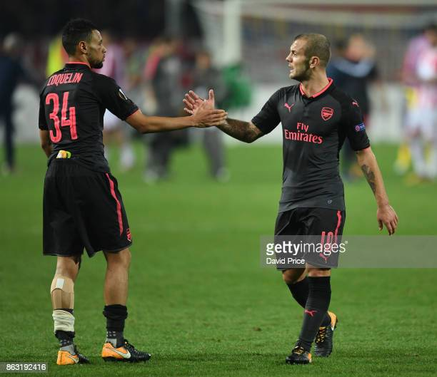 Jack Wilshere and Francis Coqulein of Arsenal after the UEFA Europa League group H match between Crvena Zvezda and Arsenal FC at Rajko Mitic Stadium...