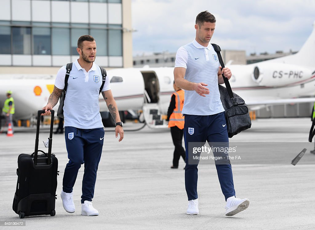 <a gi-track='captionPersonalityLinkClicked' href=/galleries/search?phrase=Jack+Wilshere&family=editorial&specificpeople=5446655 ng-click='$event.stopPropagation()'>Jack Wilshere</a> and <a gi-track='captionPersonalityLinkClicked' href=/galleries/search?phrase=Gary+Cahill&family=editorial&specificpeople=204341 ng-click='$event.stopPropagation()'>Gary Cahill</a> look on as the England team board the flight to Nice on June 26, 2016 in Paris, France.