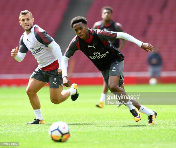 Jack Wilshere and Joe Willock of Arsenal during a training session at Emirates Stadium on August 3 2017 in London England