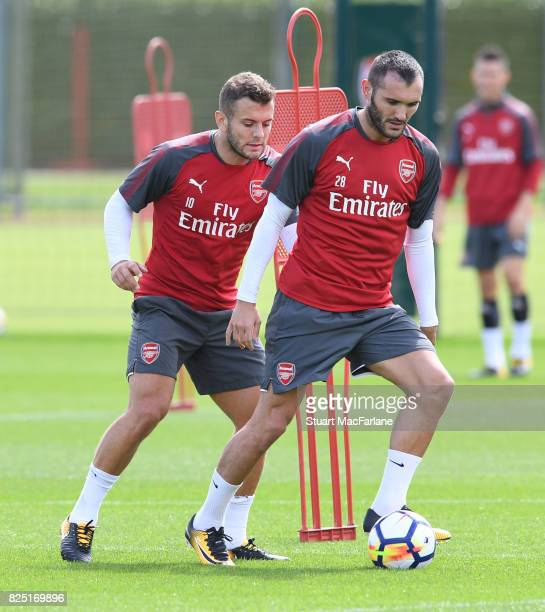 Jack Wilshere and Lucas Perez of Arsenal during a training session at London Colney on August 1 2017 in St Albans England