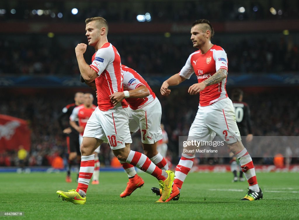 Jack Wilshere and (R) <a gi-track='captionPersonalityLinkClicked' href=/galleries/search?phrase=Mathieu+Debuchy&family=editorial&specificpeople=729104 ng-click='$event.stopPropagation()'>Mathieu Debuchy</a> celebrate the Arsenal goal, scored by Alexis Sanchez during the UEFA Champions League Qualifier 2nd leg match between Arsenal and Besiktas at Emirates Stadium on August 27, 2014 in London, United Kingdom.