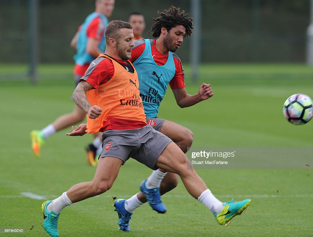 Jack Wilshere and Mohamed Elneny of Arsenal during a training session at London Colney on August 19 2016 in St Albans England