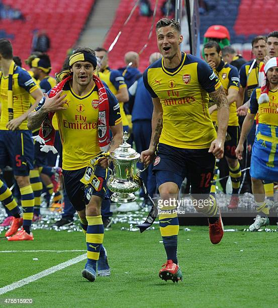 Jack Wilshere and Olivier Giroud of Arsenal with the FA Cup Trophy after the match between Arsenal and Aston Villa in the FA Cup Final at Wembley...