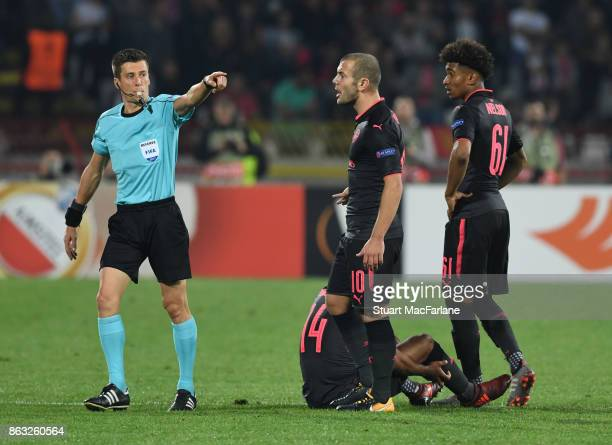 Jack Wilshere and Reiss Nelson complain to referee Benoit Bastien after a foul on The Walcott during the UEFA Europa League group H match between...