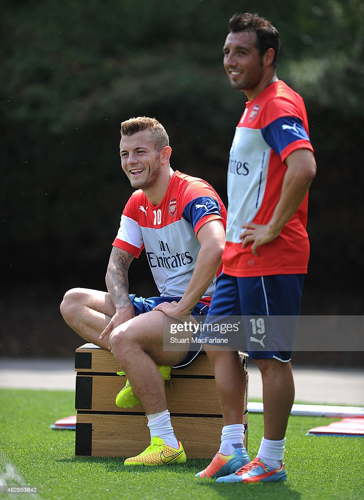 Jack Wilshere and Santi Cazorla of Arsenal during a training session at London Colney on July 23, 2014 in St Albans, England.
