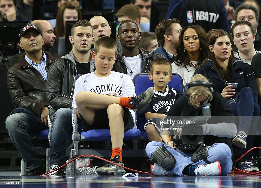 Jack Wilshere and Tamera Foster are seen during the Eastern Conference NBA match between Brooklyn Nets and Atlanta Hawks at O2 Arena on January 16, 2014 in London, England.