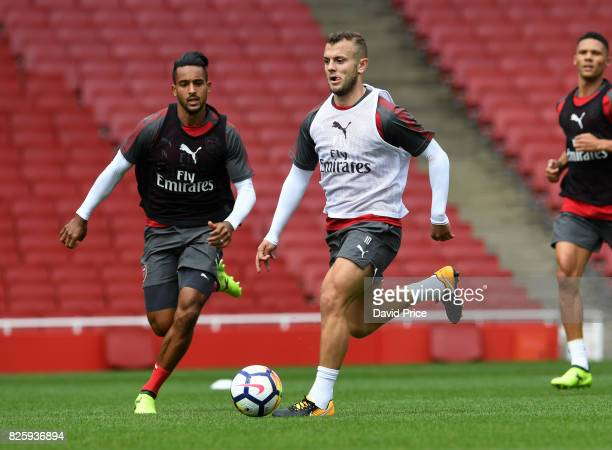 Jack Wilshere and Theo Walcott of Arsenal during the Arsenal Training Session at Emirates Stadium on August 3 2017 in London England