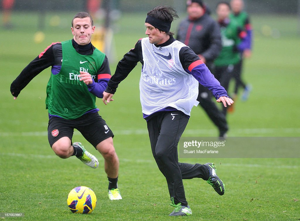 <a gi-track='captionPersonalityLinkClicked' href=/galleries/search?phrase=Jack+Wilshere&family=editorial&specificpeople=5446655 ng-click='$event.stopPropagation()'>Jack Wilshere</a> and <a gi-track='captionPersonalityLinkClicked' href=/galleries/search?phrase=Tomas+Rosicky&family=editorial&specificpeople=213988 ng-click='$event.stopPropagation()'>Tomas Rosicky</a> of Arsenal during a training session at London Colney on November 27, 2012 in St Albans, England.