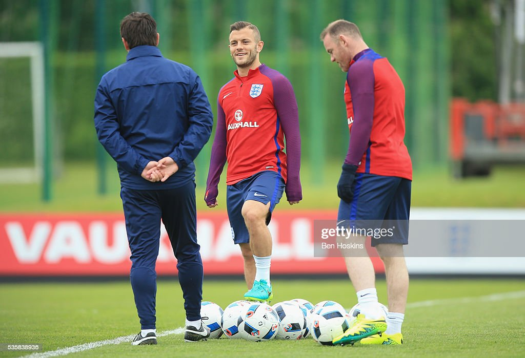 <a gi-track='captionPersonalityLinkClicked' href=/galleries/search?phrase=Jack+Wilshere&family=editorial&specificpeople=5446655 ng-click='$event.stopPropagation()'>Jack Wilshere</a> and <a gi-track='captionPersonalityLinkClicked' href=/galleries/search?phrase=Wayne+Rooney&family=editorial&specificpeople=157598 ng-click='$event.stopPropagation()'>Wayne Rooney</a> of England in conversation during an England training session at St Georges Park on May 30, 2016 in Burton on Trent, England.