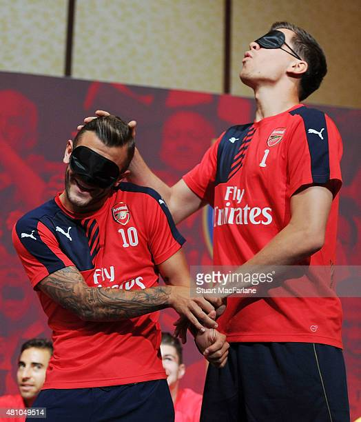 Jack Wilshere and Wojciech Szczesny of Arsenal attend a fans party at the ShnagriLa hotel on July 17 2015 in Singapore