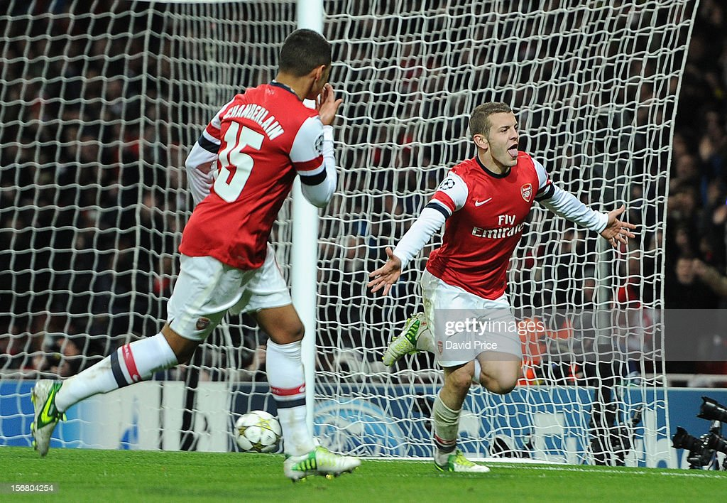 <a gi-track='captionPersonalityLinkClicked' href=/galleries/search?phrase=Jack+Wilshere&family=editorial&specificpeople=5446655 ng-click='$event.stopPropagation()'>Jack Wilshere</a> celebrates scoring Arsenal's 1st goal with <a gi-track='captionPersonalityLinkClicked' href=/galleries/search?phrase=Alex+Oxlade-Chamberlain&family=editorial&specificpeople=7191518 ng-click='$event.stopPropagation()'>Alex Oxlade-Chamberlain</a> of Arsenal during the UEFA Champions League Group B match between Arsenal FC and Montpellier Herault SC at Emirates Stadium on November 21, 2012 in London, England.