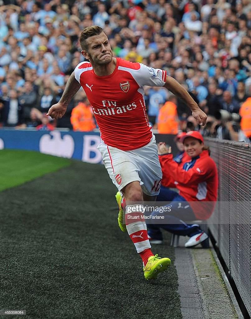 Jack Wilshere celebrates scoring for Arsenal during the Barclays Premier League match between Arsenal and Manchester City at Emirates Stadium on September 13, 2014 in London, England.
